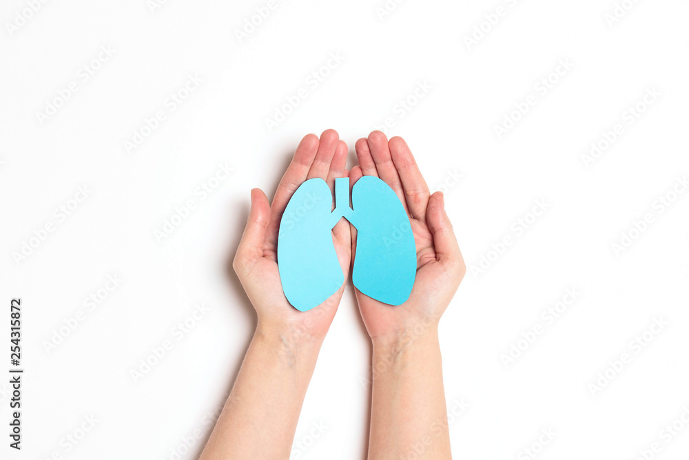 Fototapeta Women's hands hold a lungs symbol on white background. World Tuberculosis Day. Healthcare, medicine, hospital,  diagnostic, internal donor organ.