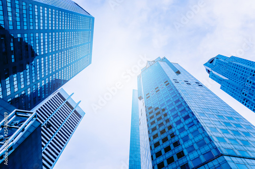 Fotobehang Aan het plafond Modern office building skyscrapers, high-rise buildings, architecture raising to the sky, top view background in blue style colors, Concepts of financial, economics, future etc.