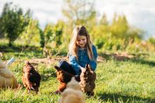 Girl Feeding Hens At The Farm