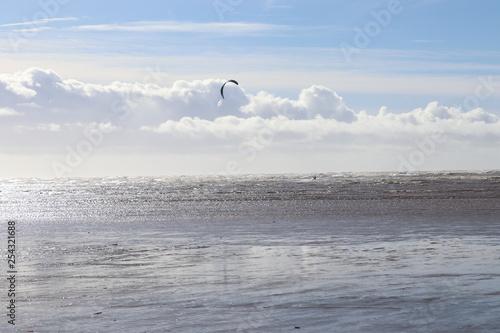 Wall Murals Ocean kite surfing on beach