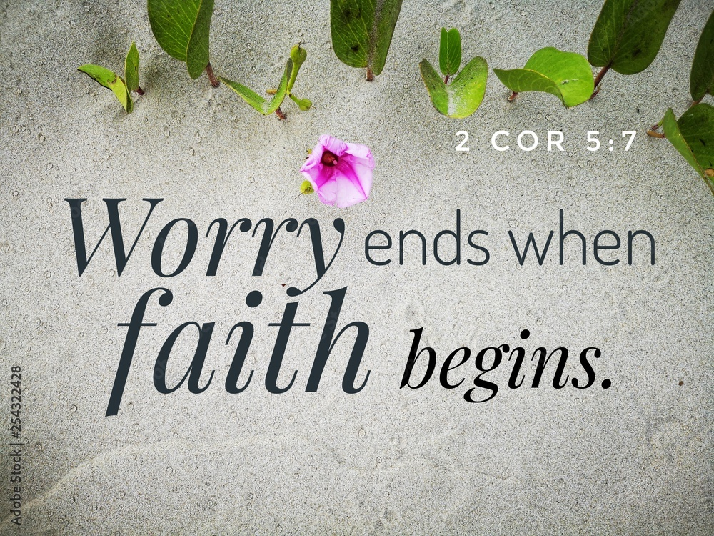Fototapeta Worry ends when faith begins with bible verse design for Christianity with sandy beach background.