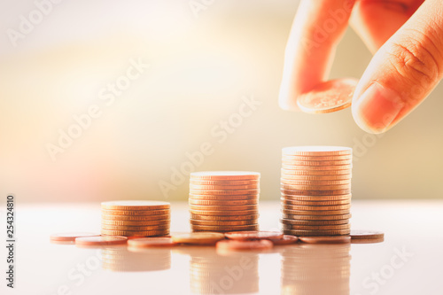 Fényképezés Money, Financial, Business Growth concept, Man's hand put money coins to stack o
