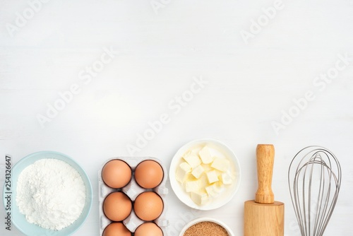 Fotografering Baking ingredients and kitchen utensils on white background