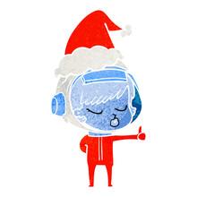 Retro Cartoon Of A Pretty Astronaut Girl Giving Thumbs Up Wearing Santa Hat