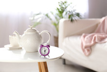 Alarm Clock, Teapot And Cup On...