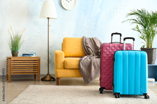 Fotografia  Packed suitcases in room. Travel concept