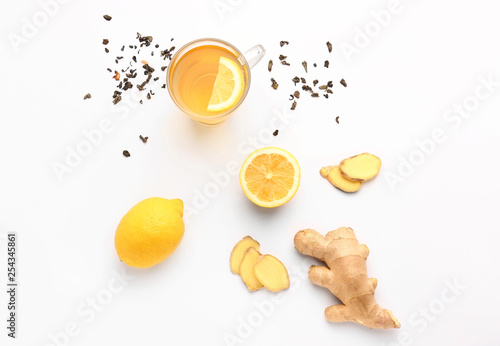 Photo  Glass of healthy drink with ginger and lemon on white background