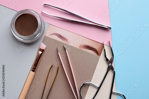 Valokuva Composition with tools for eyebrows correction on color background
