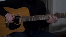 A Man Playing An Acoustic Solo...