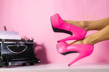 Fashion Blogger Minimal Pink Creative Concept With Typewriter And Woman Slim Legs Wearing High Heels