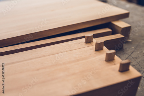 Obraz na plátne Carpentry workshop - professional woodworking - legs for a wooden table with ten
