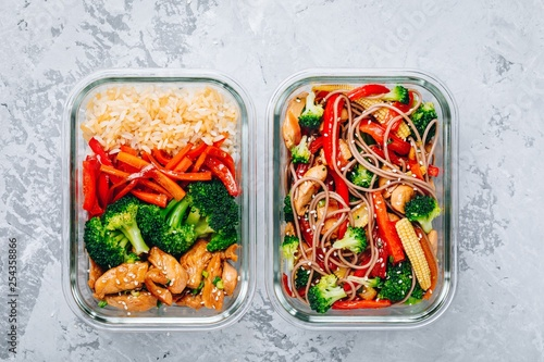 Fototapeta Chicken teriyaki stir fry meal prep containers with broccoli, carrots, rice or soba noodles obraz