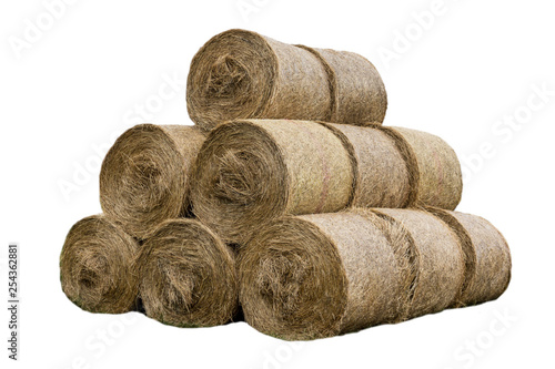 Valokuvatapetti Stacked like a pyramid, bales of straw, tightened mesh