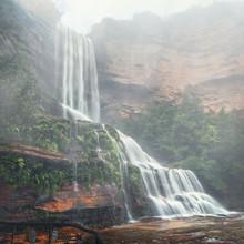 Misty Waterfalls Tumble Down Cliffs