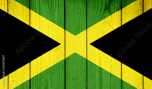 Flag of Jamaica on wooden background Fototapeta