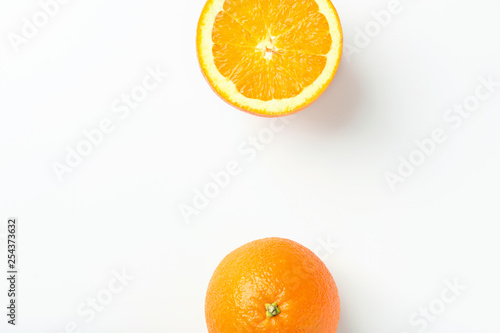 Border frame from ripe juicy organic oranges on white background. Top view flat lay. Vibrant color. Vitamins healthy lifestyle vegan superfoods concept. Creative food poster banner