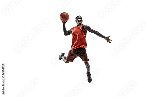 Fotografie, Tablou Full length portrait of a basketball player with a ball isolated on white studio background