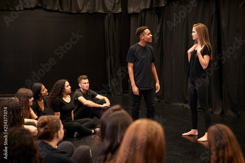 Fotografie, Obraz  Male And Female Drama Students At Performing Arts School In Studio Improvisation