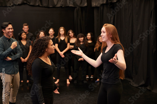 Fototapeta Teacher With Male And Female Drama Students At Performing Arts School In Studio