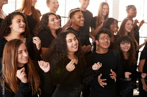 Fototapeta Male And Female Students Singing In Choir At Performing Arts School obraz