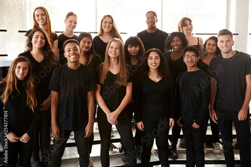 Portrait Of Male And Female Students Singing In Choir At Performing Arts School - 254377814
