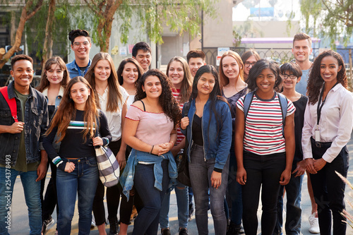 Fotografiet  Portrait Of Smiling Male And Female College Students With Teachers Outside Schoo
