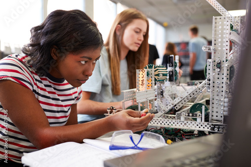 Photo Two Female College Students Building Machine In Science Robotics Or Engineering