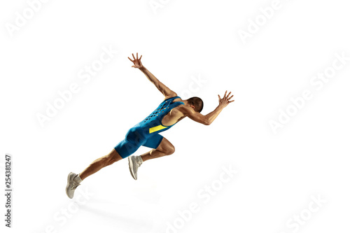 Fotomural Young caucasian man running isolated on white studio background
