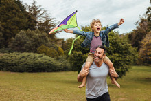 Father Carrying Son Playing Wi...
