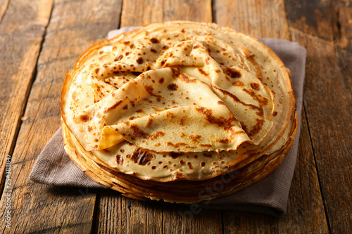 stack of crepe on wood background