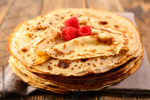 stack of crepe and raspberry