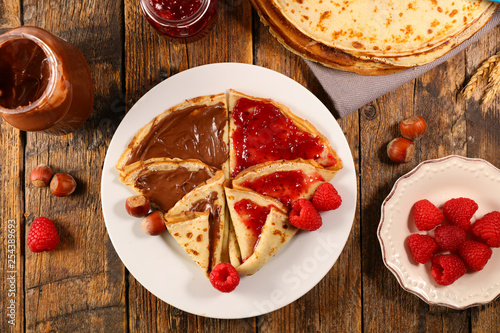 pancakes crepes with chocolate and raspberry jam