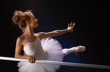 Ballet Dancer Posing By Bar