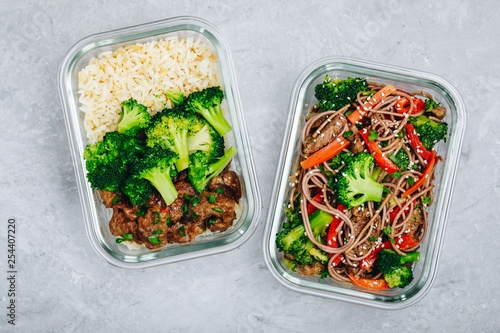 Fototapeta Beef and broccoli stir fry meal prep lunch box containers with rice or noodles obraz