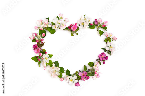 Poster Fleur Frame of flowers apple tree in the shape heart on white background with space for text. Top view, flat lay