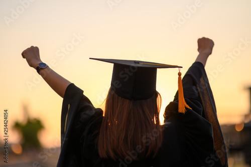 Graduates wear a black dress, black hat at the university level. Canvas Print