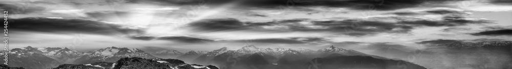 Fototapeta Black and white panoramic view of mountain peaks