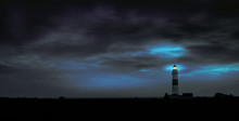 Lighthouse In Front Of A Drama...