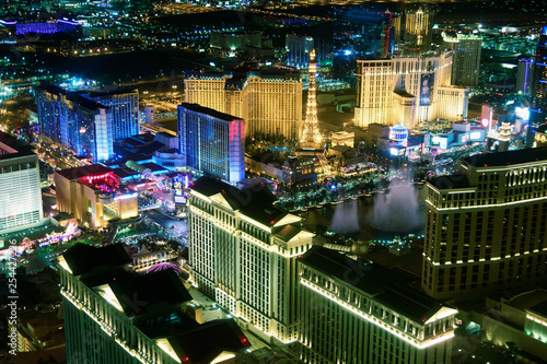 Staande foto Las Vegas Casinos of Las Vegas with night show, aerial view at night from helicopter