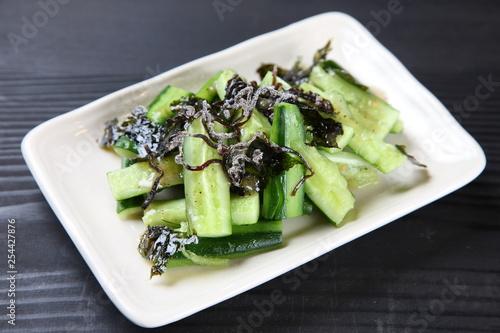 Fototapeta cucumber with salt kelp obraz
