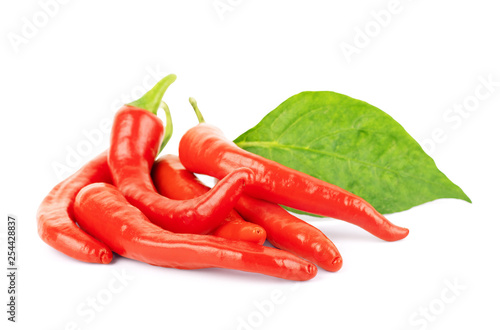 Photo Stands Hot chili peppers Red hot chili pepper with leaves on a white background