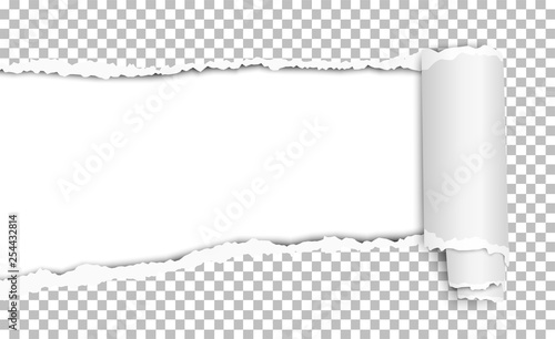 Photo  Oblong torn hole in transparent sheet of paper with shadow and paper curl