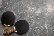 Black Racket For Ping Pong Ball Gray Background Top View