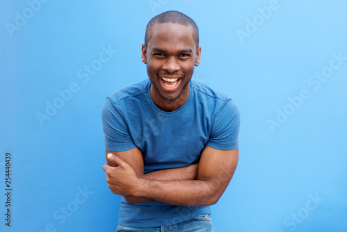 Fotografie, Obraz  handsome young african american man laughing with arms crossed