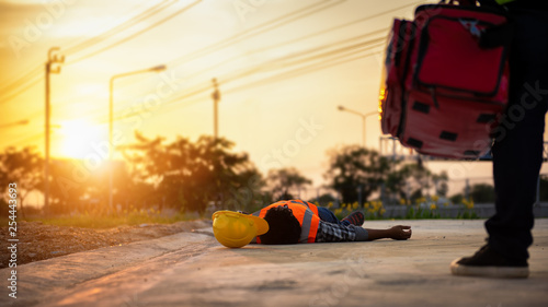 Fotografie, Obraz  Accident at work of construction labor people, Basic First aid and CPR Training at outdoor