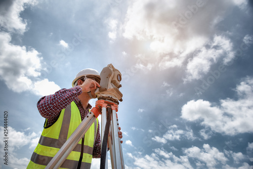 Obraz Surveyor equipment. Surveyor's telescope at construction site or Surveying for making contour plans are a graphical representation of the lay of the land before startup construction work - fototapety do salonu