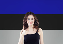 Estonia. Happy Girl Showing Thumb Up And Smiling On Estonian Flag Background