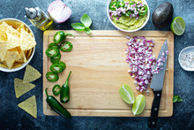 A Cutting Board With Jalapeno,...