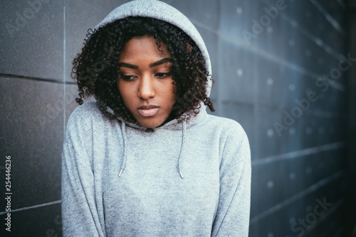 Sad and lonely teenager portrait in the city street Wallpaper Mural