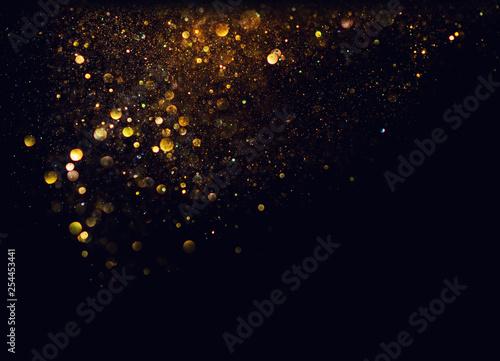 Photo glitter vintage lights background. gold and black. de focused
